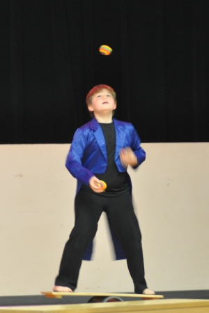 This is me juggling 3 balls while balancing on the rolla-bolla.
