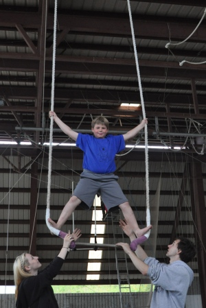 Standing on the staionary trapeze