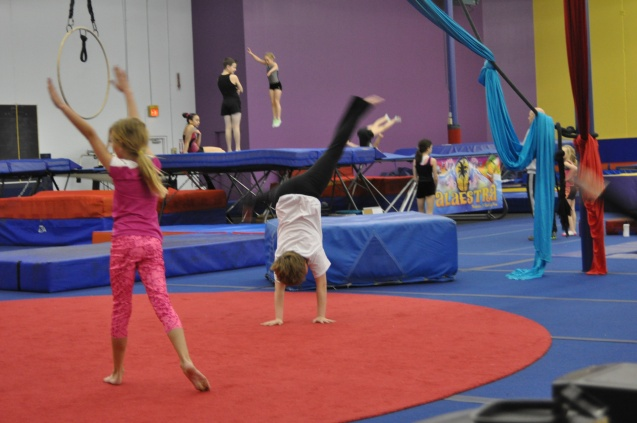 We spend a lot of time cartwheeling and tumbling and dancing up and down the gym.