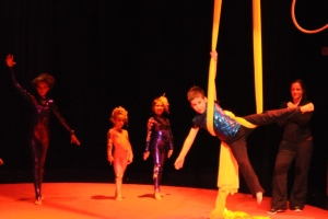 Young boy performing on circus silks