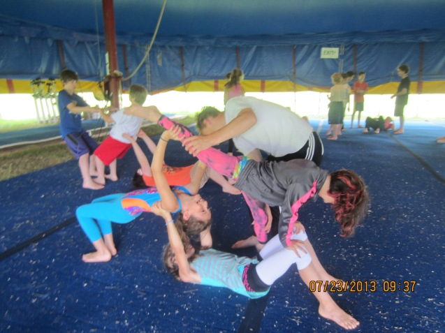 Acro class Circus Smirkus Session IV 2013. (Kameron is in the red shorts & white T-shirt in the upper left of this photo.)