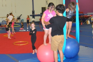 Aaliyah Martinez on balance ball at Lone Star Circus School