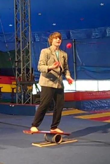 Juggling on Rolla Bolla screencap cropped portrait