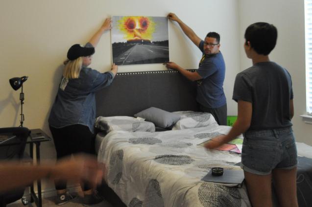 Crew setting up Jacob's bedroom Beyond the Bridge